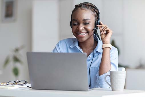 Customer Support. Black woman manager wearing headset and using